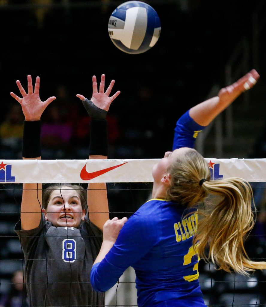 Byron Nelson's Paige Flickinger (8) attempts to block Schertz Clemens' Ashley Breu's (3) hit during the first set of a class 6A volleyball state semifinal match at the Curtis Culwell Center in Garland, on Friday, November 22, 2019. Nelson won the first set 32-30. (Juan Figueroa/The Dallas Morning News)