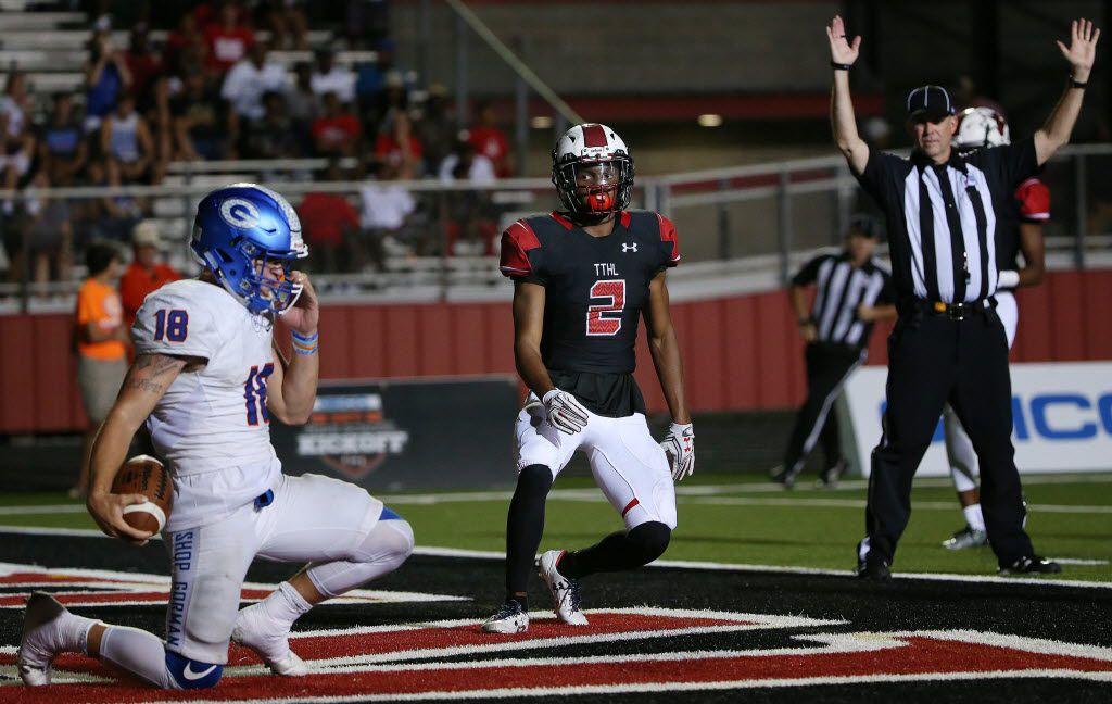 Cedar Hill cornerback Caleb Lawton (2) watch on after he was unable to reach Bishop Gorman quarterback Tate Martell (18) as Martell scores a touchdown to make the score 36-14 in the second half during a high school football game between Bishop Gorman, of Las Vegas, Nevada, and Cedar Hill at Longhorn Stadium in Cedar Hill, Texas Saturday August 27, 2016. (Andy Jacobsohn/The Dallas Morning News)