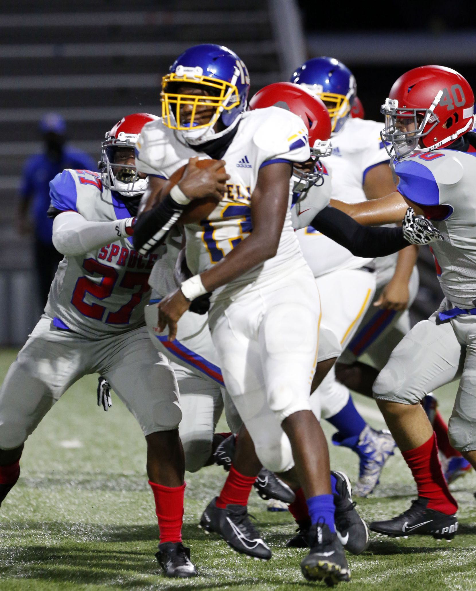 Samuell's De'Quan'Dre Brown (13) picks up a couple of yards during the first half of the season opening high school football game between against Samuell and Spruce High at Pleasant Grove Stadium in Dallas on Friday, August 27, 2021. (John F. Rhodes / Special Contributor)