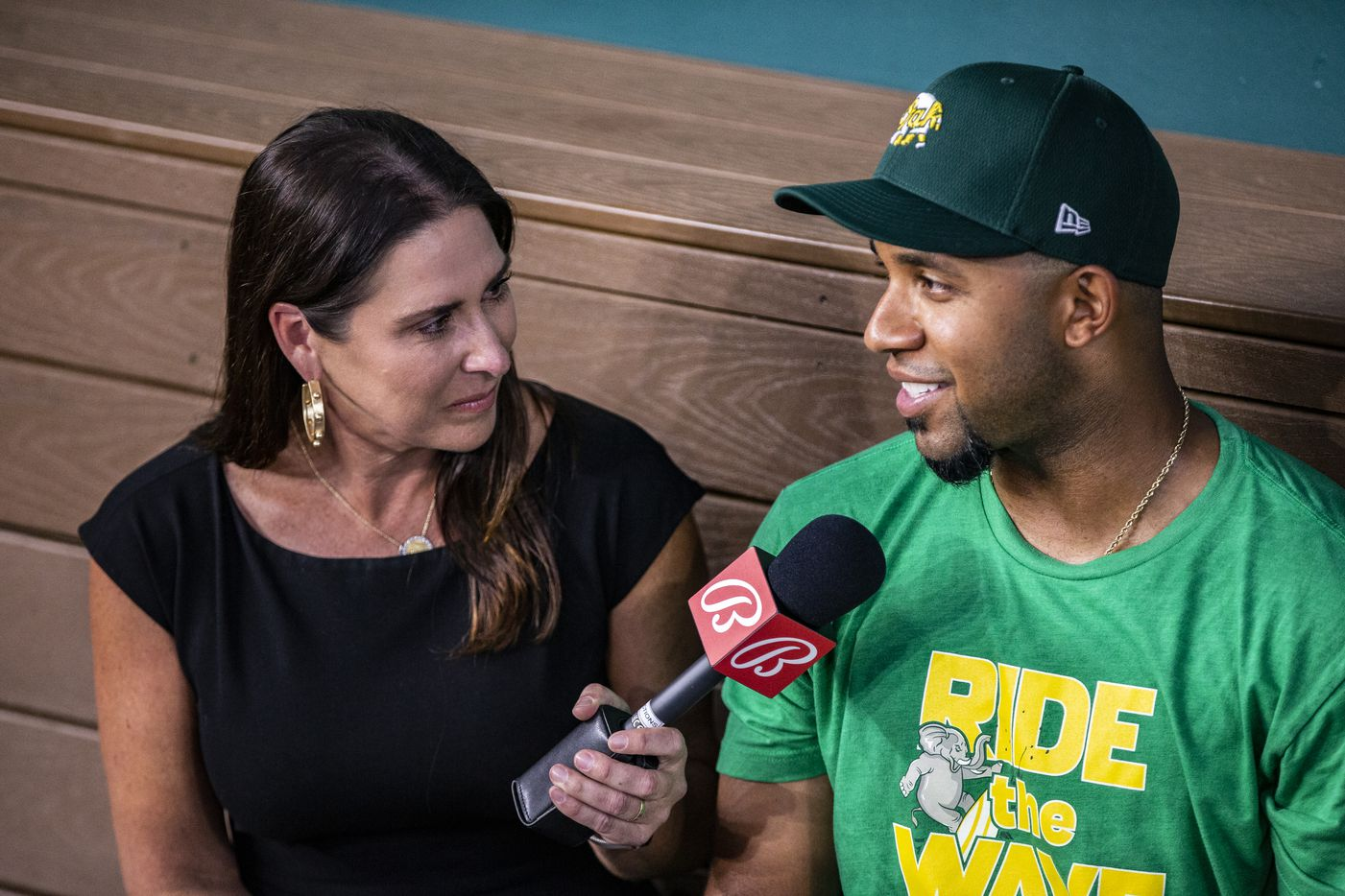 Oakland Athletics shortstop Elvis Andrus, right, speaks too broadcaster Emily Jones before a game against the Texas Rangers in Arlington, Monday, June 21, 2021. (Brandon Wade/Special Contributor)