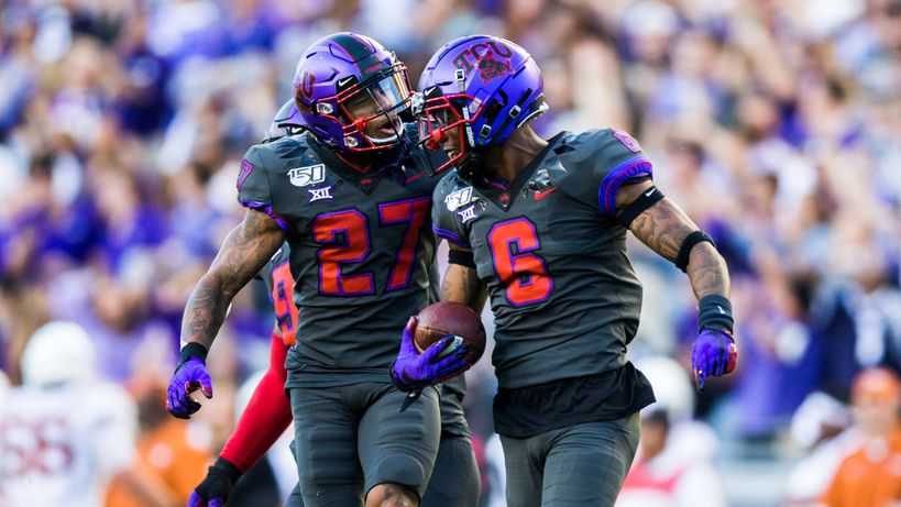TCU Horned Frogs safety Ar'Darius Washington (27) and safety Innis Gaines (6) celebrate after Gaines caught an interception that clenched a TCU win during the fourth quarter of an NCAA football game between the University of Texas and TCU on Saturday, October 26, 2019 at Amon G Carter Stadium in Fort Worth.