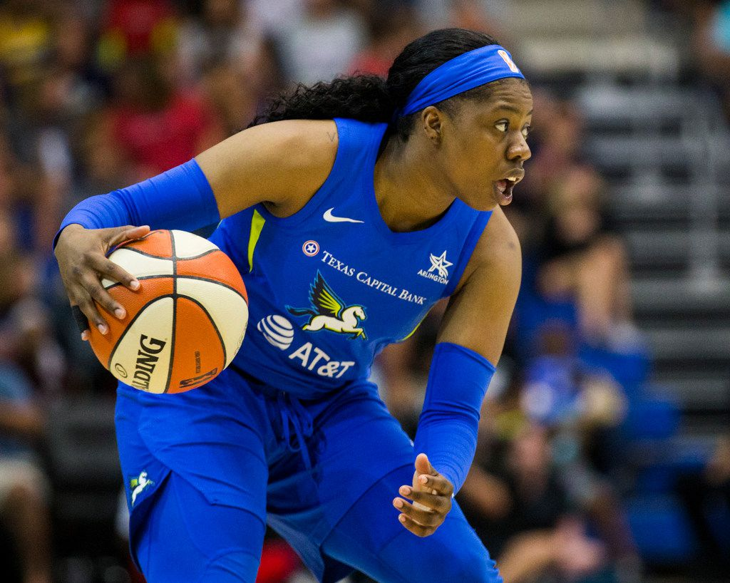Dallas Wings guard Arike Ogunbowale (24) looks for a pass during the second quarter of a WNBA game between the Dallas Wings and the Indiana Fever on Friday, July 5, 2019 at UTA's College Park Center in Arlington.
