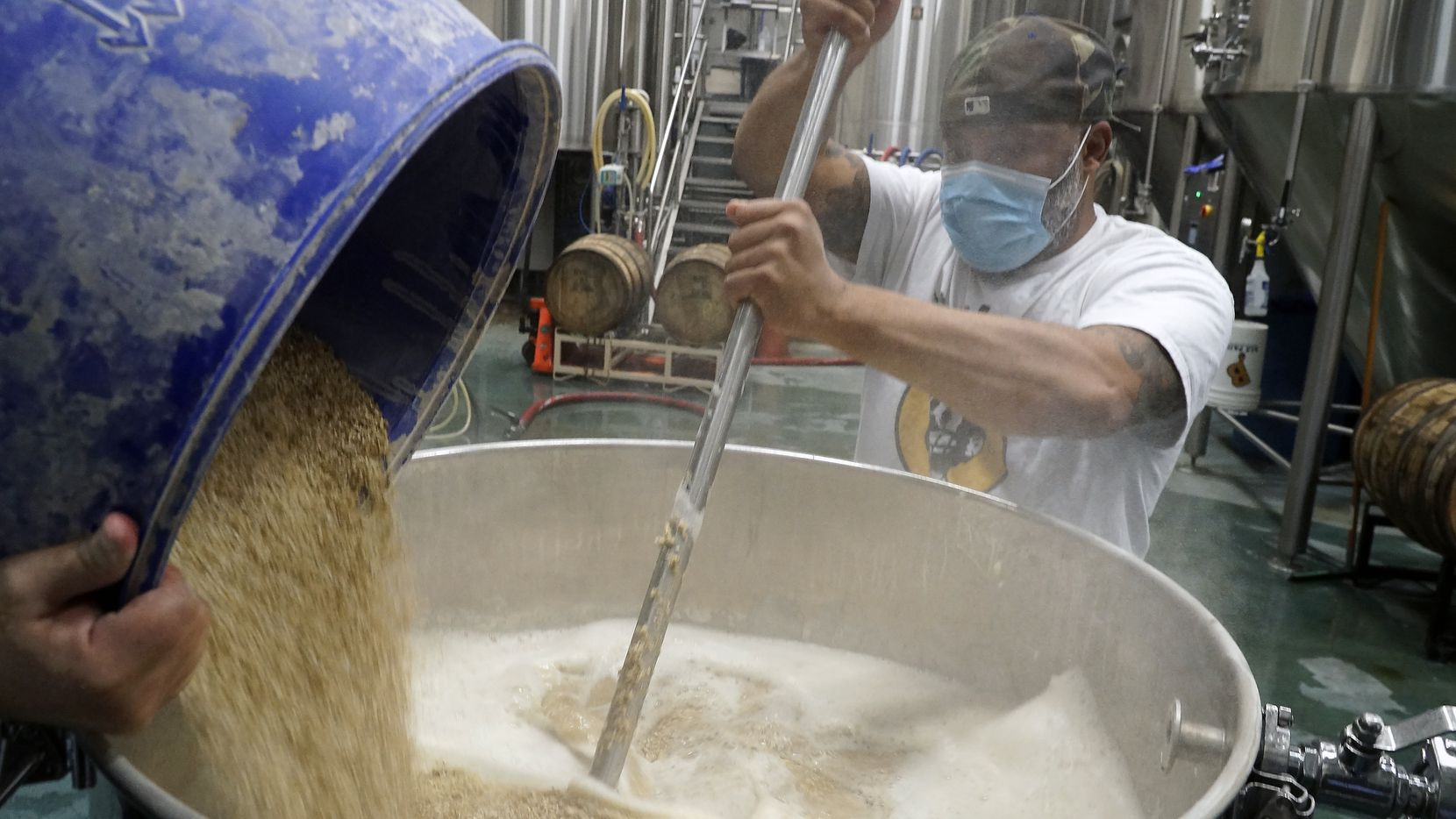Kuumba Smith mashes the grain for a kettle sour beer he's making at Hop & Sting Brewing Co. in Grapevine.