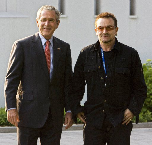 Former President George W. Bush walks with Bono (R) in June 2007 before a meeting at the on the Baltic Sea resort of Heiligendamm, northeastern Germany.