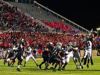 Ryan junior linebacker Tyreke Davis (21) tips a pass from Guyer junior quarterback Shawn Robinson (3), Friday, November 6, 2015, at C.H. Collins Athletic Complex in Denton, TX. David Minton/DRC