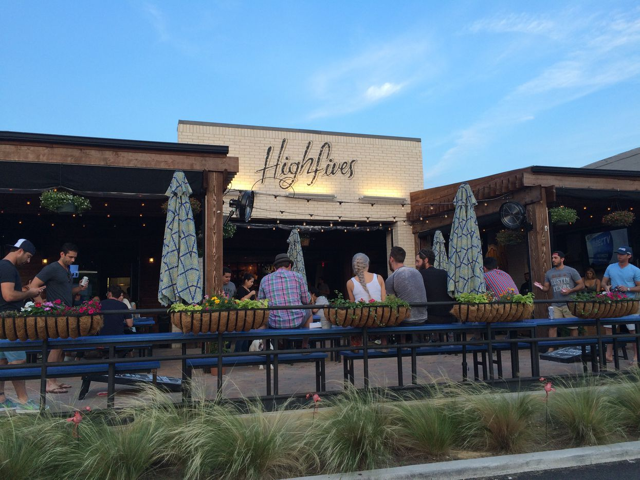 Dallas bar High Fives, pictured here when it opened in 2015 on Henderson Avenue in Dallas, was shut down by Gov. Greg Abbott's latest ruling. Co-owner Brandon Hays and other bar owners sued Gov. Abbott on July 8, 2020. On July 21, 2020, a Dallas County judge ordered the depositions of two billionaires who serve on Abbott's COVID-19 task force.