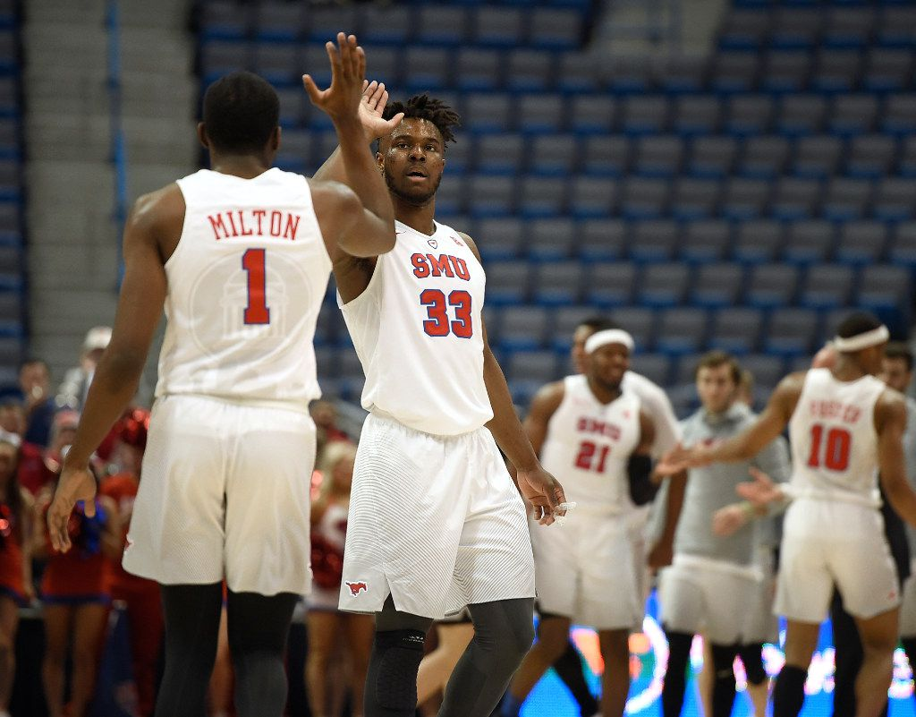 SMU's Semi Ojeleye (33) high-fives teammate Shake Milton, left, during the first half of an NCAA college basketball game against East Carolina in the American Athletic Conference tournament quarterfinals, Friday, March 10, 2017, in Hartford, Conn. (AP Photo/Jessica Hill)
