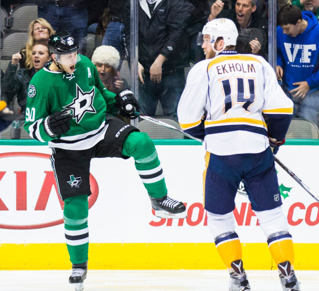 Dallas Stars center Jason Spezza (90) celebrates a goal in front of Nashville Predators defenseman Mattias Ekholm (14) during the second period of their game on Thursday, December 8, 2016 at the American Airlines Center in Dallas. (Ashley Landis/The Dallas Morning News)