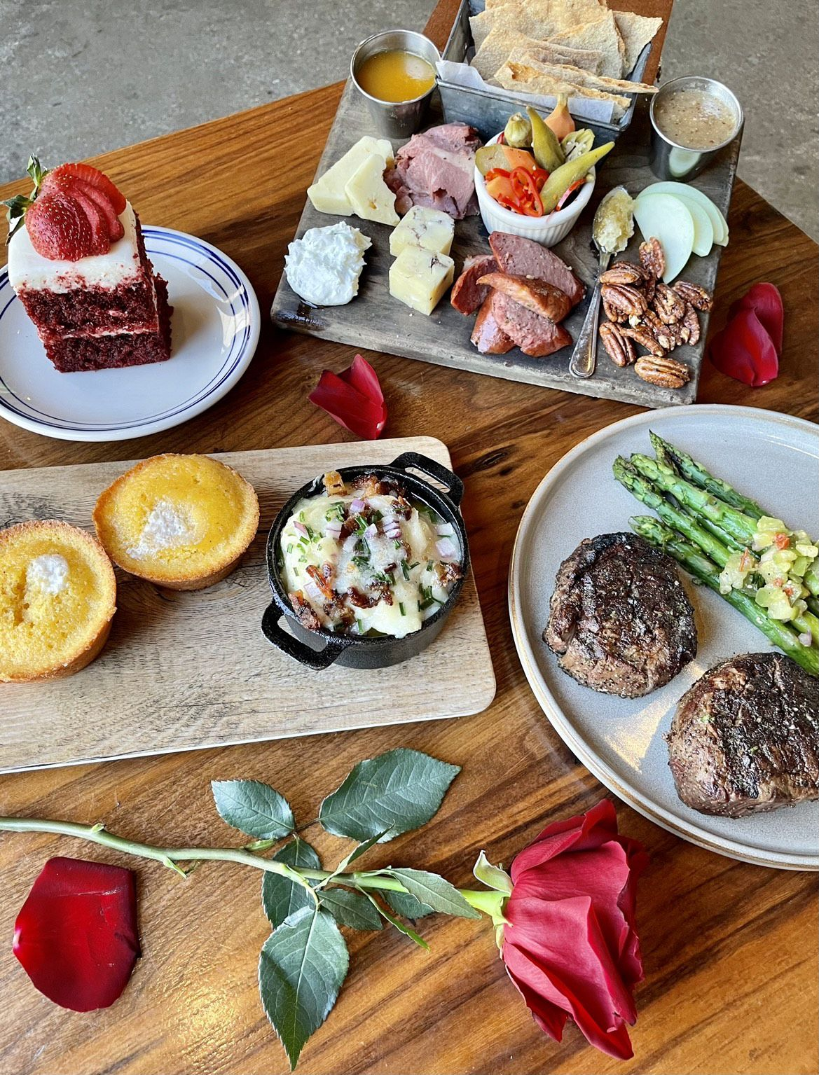 Haywire and The Ranch at Las Colinas offer the ready-to-heat Valentine s Day Couples Kit that includes a meat and cheese board, two 8-ounce filets, loaded mashed potatoes, grilled asparagus, cornbread and a a slice of four-layer red velvet cake.
