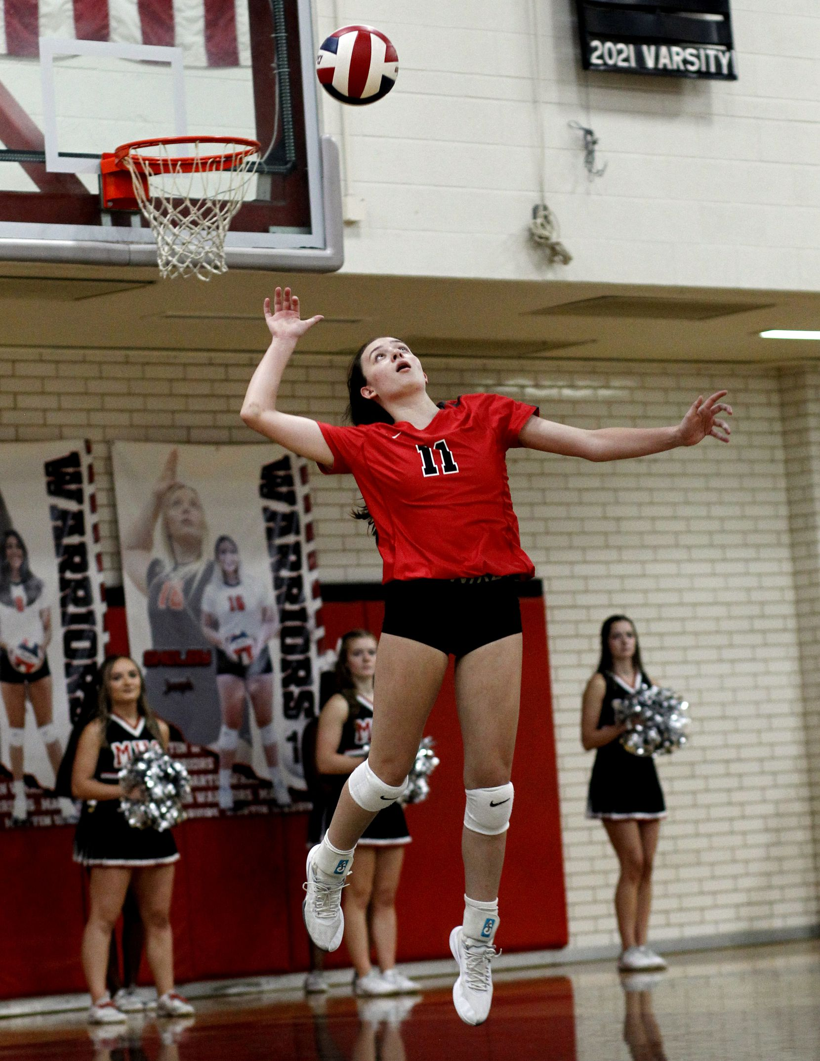 Arlington Martin's Madeline Hopp (11) serves during the 3rd set of the Warriors' straight set victory over South Grand Prairie. The two teams played their volleyball match at Arlington Martin High School in Arlington on September 14, 2021. (Steve Hamm/ Special Contributor)