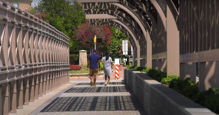 A 10-foot wide canopied walkway on Legacy Road crosses over the Dallas North Tollway.