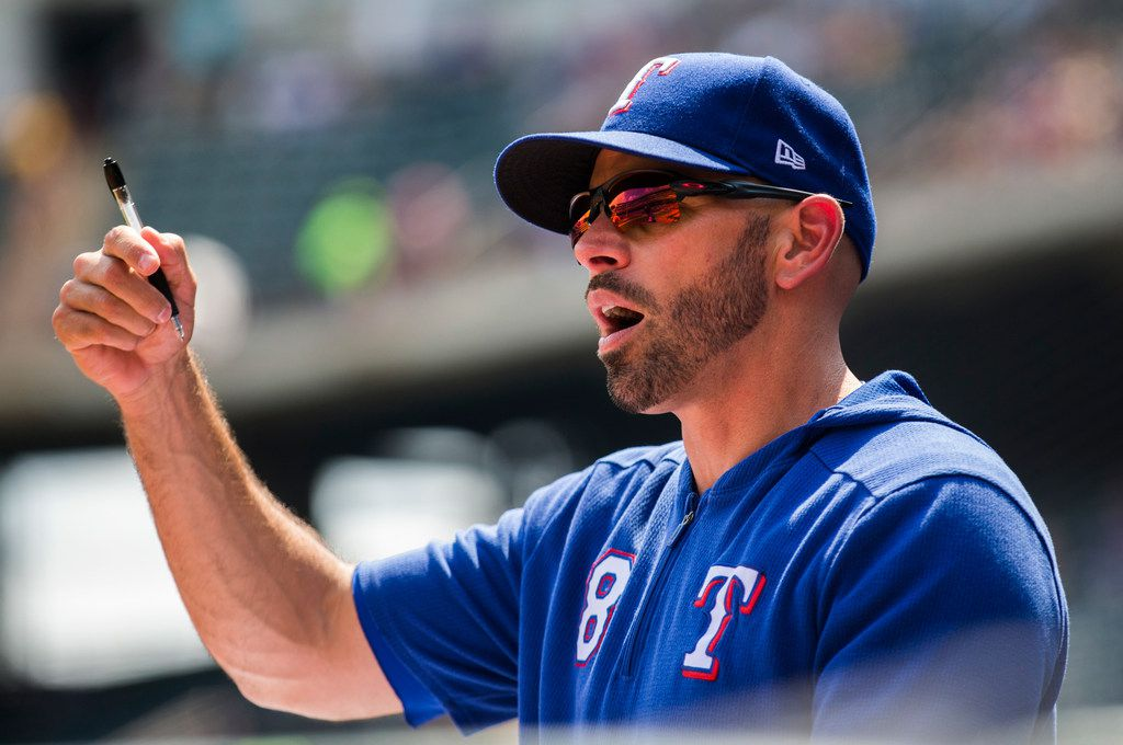 Texas Rangers manager Chris Woodward (8) gives instructions in the dugout during the first inning of an MLB game between the Texas Rangers and the Seattle Mariners on Sunday, September 1, 2019 at Globe Life Park in Arlington.