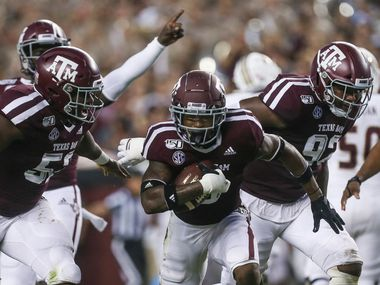 Texas A&M Aggies defensive back Leon O'Neal Jr. (9), middle, celebrates with defensive lineman Justin Madubuike (52), left, and defensive lineman Jayden Peevy (92), right after making a play during the first quarter of a college football game between Texas A&M and Texas State on Thursday, Aug. 29, 2019 at Kyle Field in College Station, Texas.