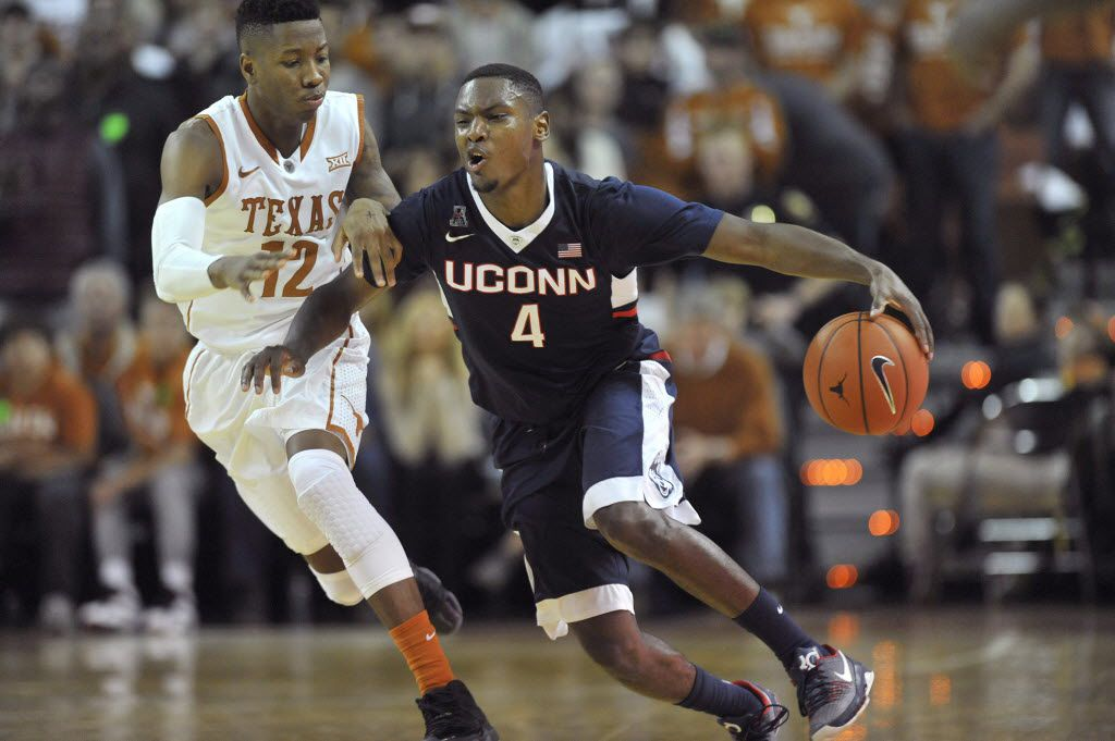 Connecticut Huskies guard Sterling Gibbs (4) is fouled by Texas Longhorns guard Kerwin Roach Jr. (12) on Tuesday, Dec. 29, 2015, at the Frank Erwin Center in Austin, Texas. (Brad Horrigan/Hartford Courant/TNS)