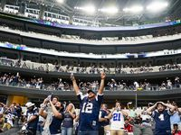 Dallas Cowboys fans celebrate after a long reception by wide receiver Amari Cooper during the third quarter of an NFL football game against the Atlanta Falcons at AT&T Stadium on Sunday, Sept. 20, 2020, in Arlington.