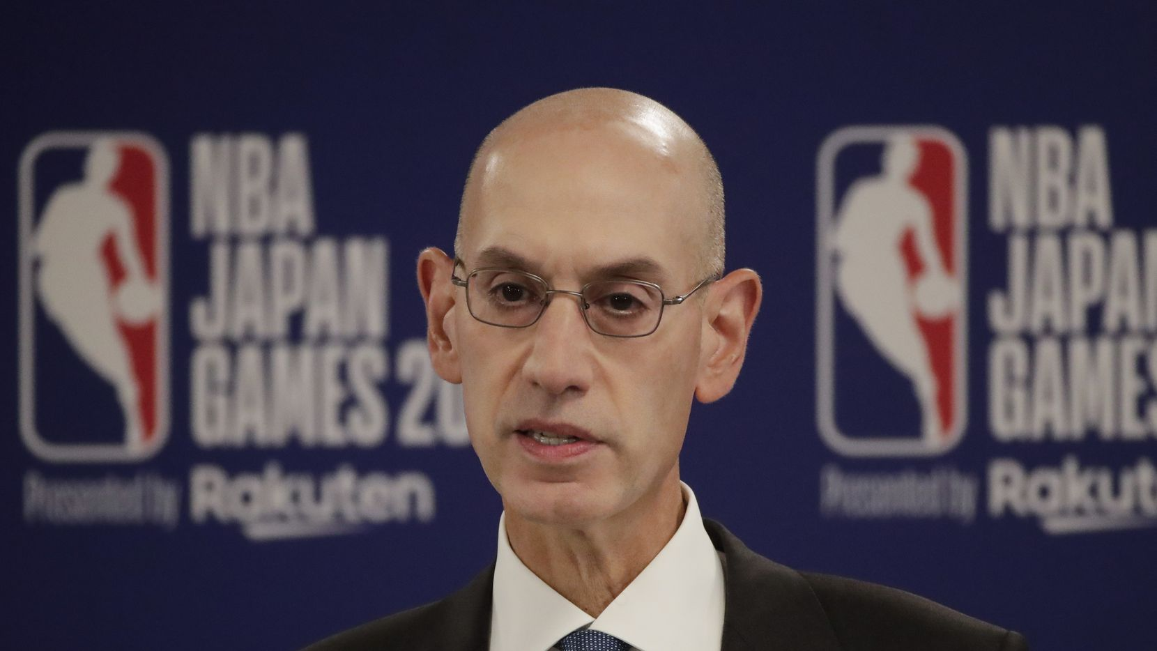 FILE - In this Oct. 8, 2019 file photo, NBA Commissioner Adam Silver speaks at a news conference before an NBA preseason basketball game between the Houston Rockets and the Toronto Raptors in Saitama, near Tokyo. When major corporations have angered Chinese authorities in recent years, the playbook calls for one thing: an apology.  The NBA, with billions at stake, has resisted that for now, though some experts wonder if such a move is inevitable.