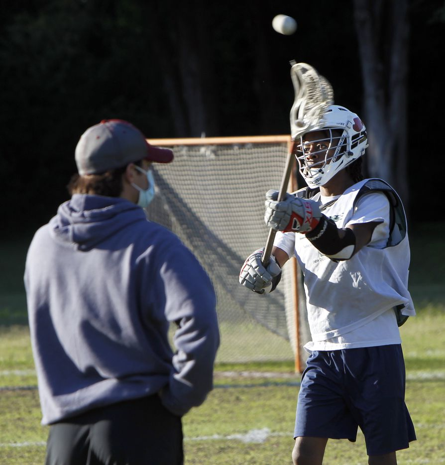 Jason Mentif goes through a drill during a practice session for the Bridge Eagles lacrosse team. The Bridge lacrosse team held their Wednesday evening practice session at the JC Phelps Recreation Center in Dallas on May 5, 2021.
