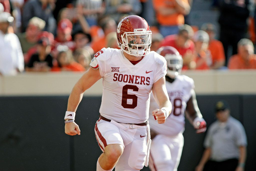 STILLWATER, OK - NOVEMBER 04: Quarterback Baker Mayfield #6 of the Oklahoma Sooners celebrates a touchdown against the Oklahoma State Cowboys at Boone Pickens Stadium on Nov. 4, 2017, in Stillwater, Okla. Oklahoma defeated Oklahoma State 62-52.  (Photo by Brett Deering/Getty Images)