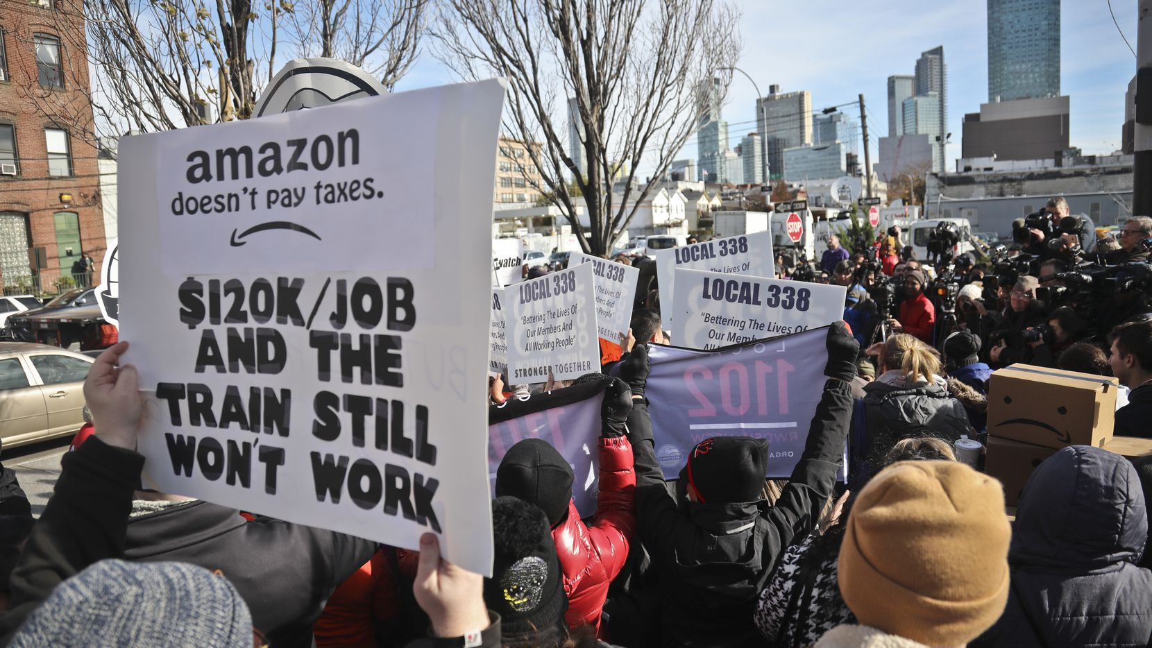In Long Island City, N.Y., protesters objected to the huge tax breaks that Amazon will get for creating a second headquarters. Some lawmakers have threatened to stop the incentives, and one proposes using the money for student debt.