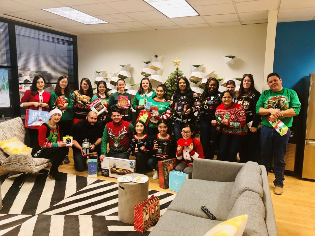 Presidium workers hammed it up at a holiday ugly sweater gift exchange.