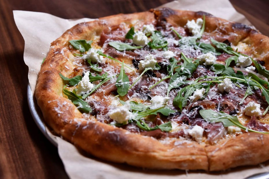 Prosciutto pizza with mission fig, goat cheese and arugula from North Italia in Dallas