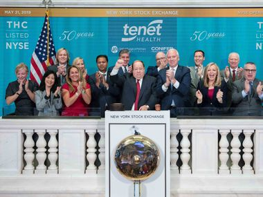 Tenet Healthcare leaders rang the opening bell at the New York Stock Exchange on May 21, 2019. CEO Ronald Rittenmeyer is in the middle with his right arm raised.