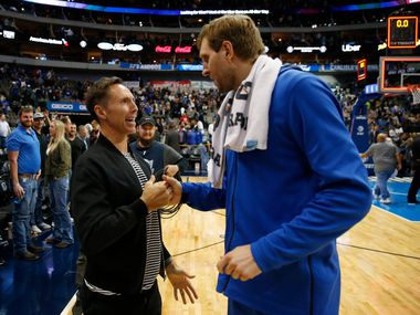 Former teammate Steve Nash and Dallas Mavericks forward Dirk Nowitzki (41) talk after a game against the Philadelphia 76ers during the second half of play at the American Airlines Center in Dallas on Monday, April 1, 2019.