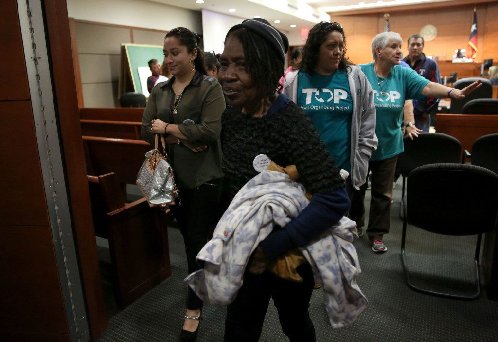 Pearlie Mae Brown, an HMK tenant, left a packed courtroom on Monday morning after a state district judge granted another delay in mass evictions. (Rose Baca/The Dallas Morning News)