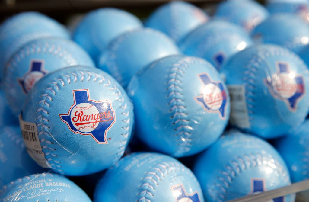 Powder blue Texas Rangers baseballs on display during the unveiling of the 2020 uniforms at Live! next to Globe Life Field in Arlington, Texas on Wednesday, December 4, 2019. (Vernon Bryant/The Dallas Morning News)