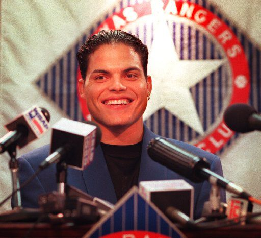 ORG XMIT:  Texas Ranger's star catcher Ivan 'Pudge' Rodriguez was ALL smiles, as he talked with the press about his 5- year-long (and $42 million) contract extension with the team. A  meeting with the team President (and some contract restructuring)  consummated the deal Thursday morning.   Photographer: RHODES, John F.  Credit: 106273  Date: 19970731