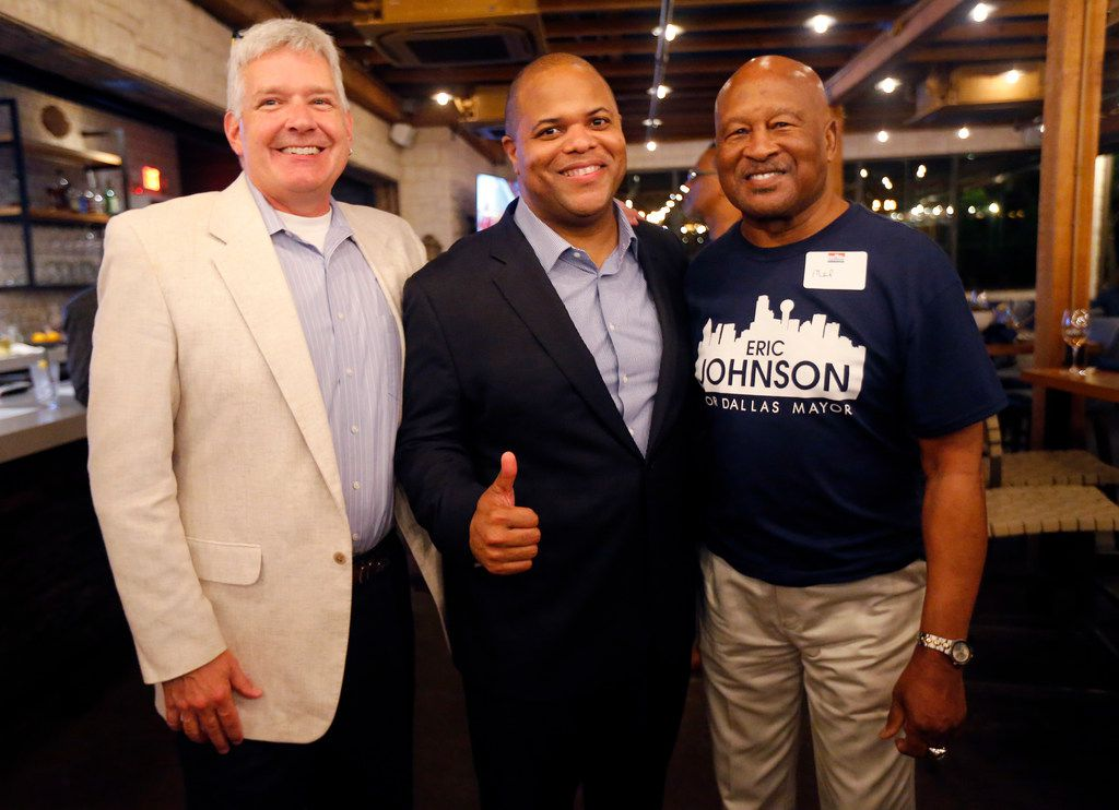 Dallas mayoral candidate and current State Representative Eric Johnson (center) poses for a photo with his Greenhill School football coach Tom Perryman (left) and Dallas Cowboys great Mel Renfro during an election night party at Smoky Rose restaurant Saturday night in Dallas.