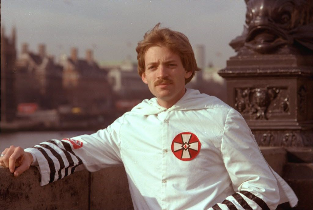 David Duke, a 27-year-old Ku Klux Klan leader in March 1978, posed in his Klan robes in front of Parliament in London.  Although he was banned from entering Britain, he arrived on a Skytrain flight from New York. (File Photo/The Associated Press)