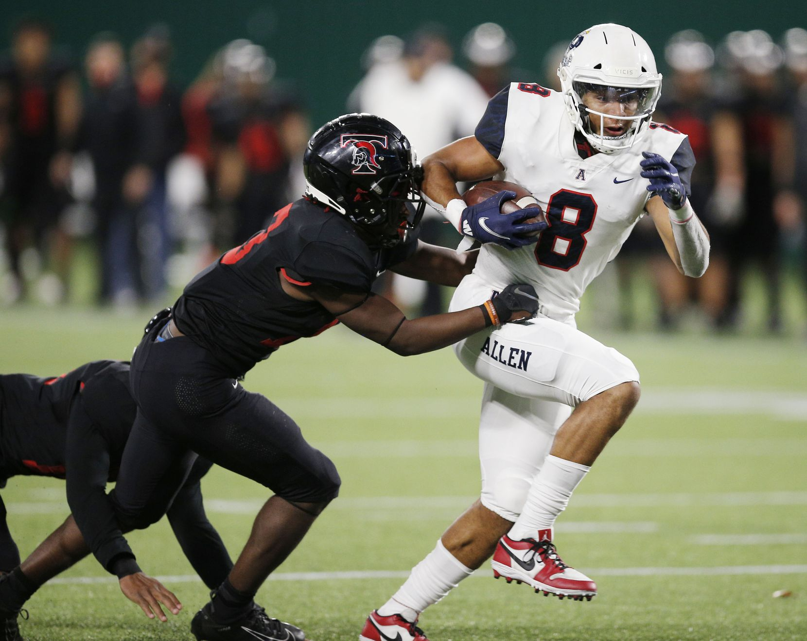 Allen senior wide receiver Blaine Green (8) breaks past Euless Trinity junior defensive back Jacob Schaeffer (13) to score a touchdown during the first half of a high school Class 6A Division I Region I semifinal football game at Globe Life Park in Arlington, Saturday, December 26, 2020. (Brandon Wade/Special Contributor)
