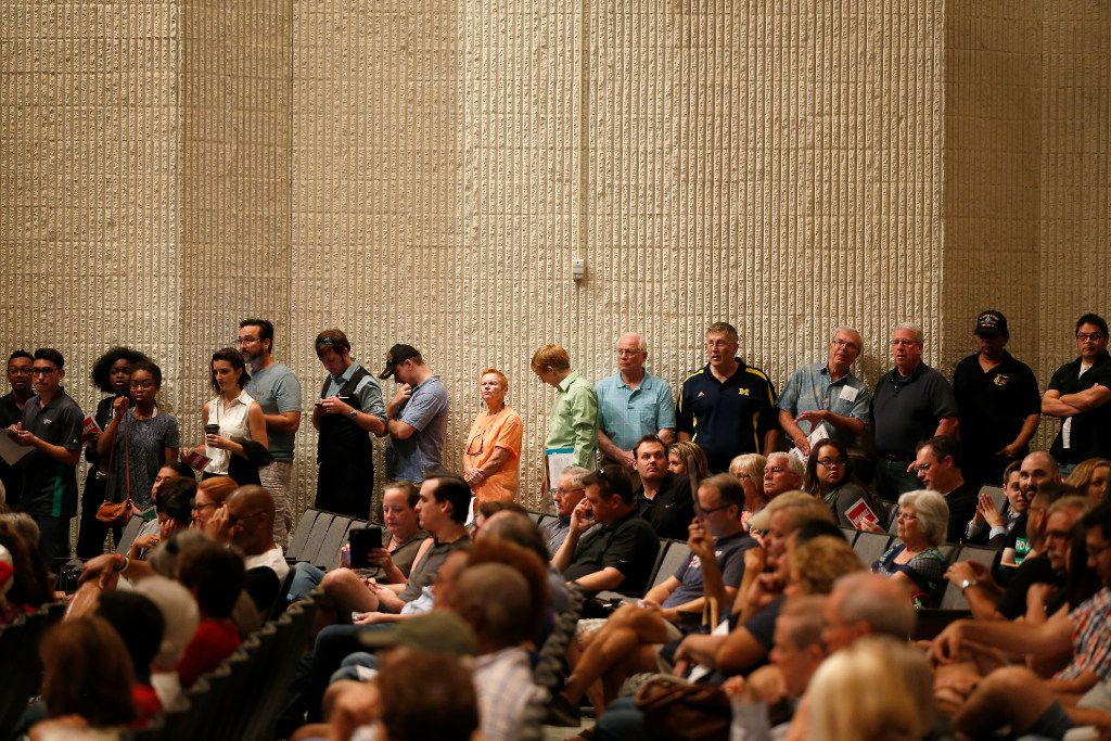 People stay in line to ask questions for Rep. Michael Burgess during an open forum town hall meeting at The Colony High School Auditorium in The Colony on Aug. 5.