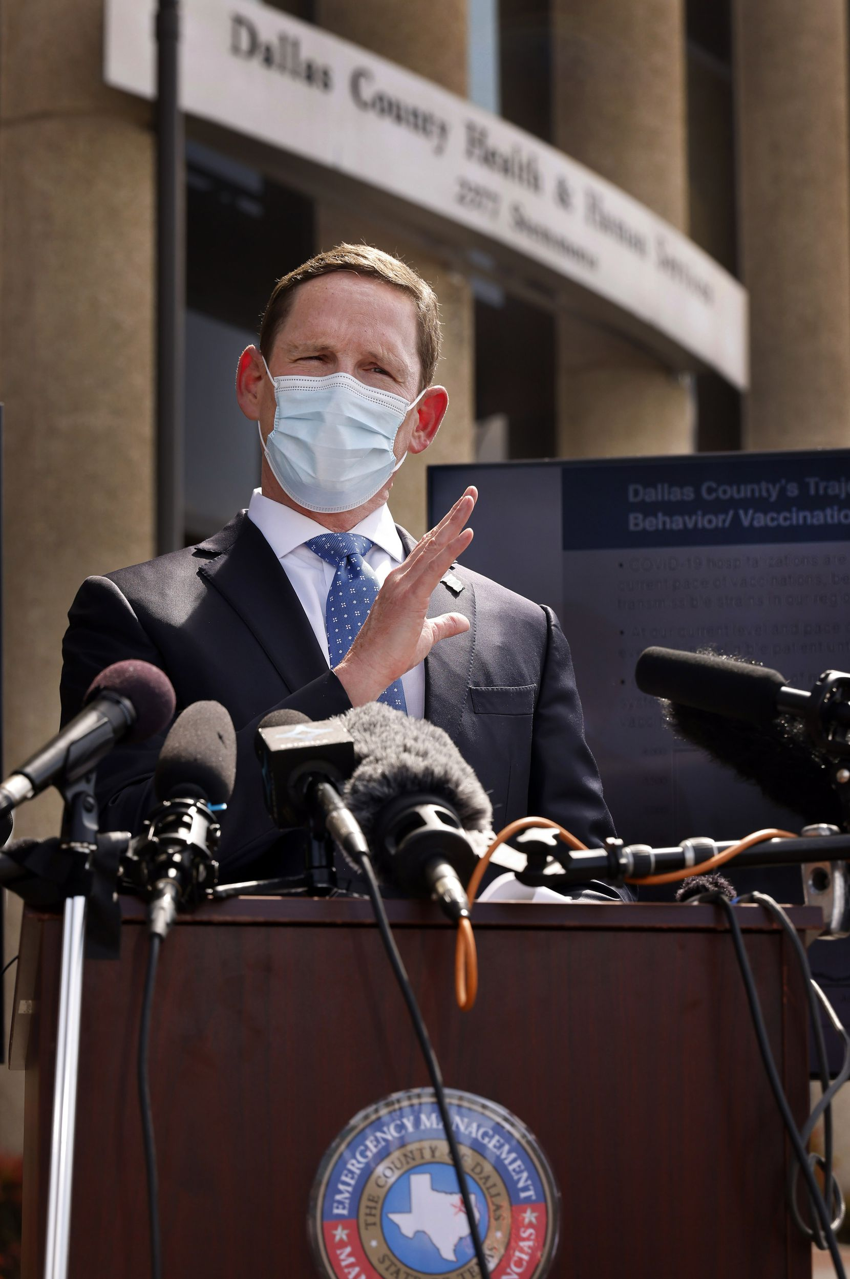 Dallas County Judge Clay Jenkins addressed the media about the current state of the delta coronavirus variant outside the Dallas County Health and Human Services building Tuesday. (Tom Fox/The Dallas Morning News)