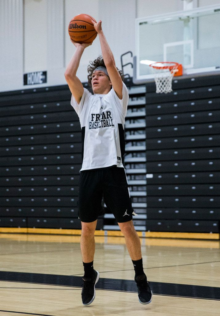Bishop Lynch High School varsity basketball player Jarett Nunez takes a shot during practice on Thursday, January 24, 2019 at Bishop Lynch High School in Dallas. Nunez was born with a deformed left hand, but that didn't stop him from making the varsity basketball team, running track or playing football. (Ashley Landis/The Dallas Morning News)