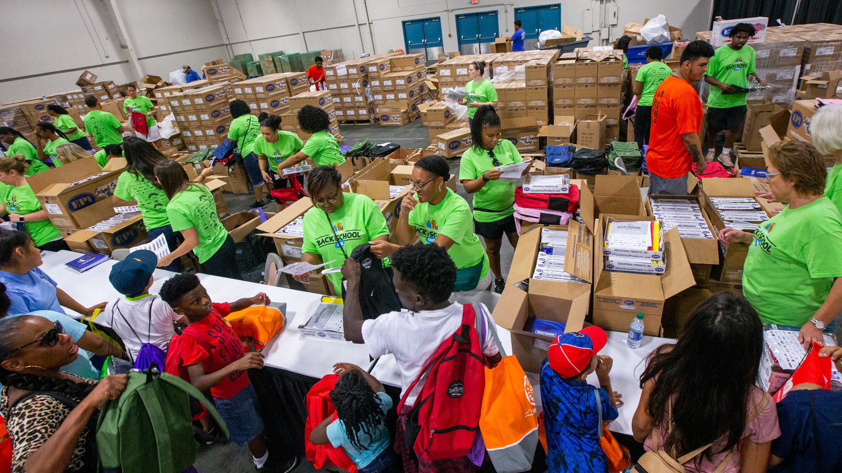 Families waited in line to receive free backpacks and school supplies during the 23rd annual Mayor's Back to School Fair at Fair Park Centennial Hall in Dallas on Aug. 2, 2019.