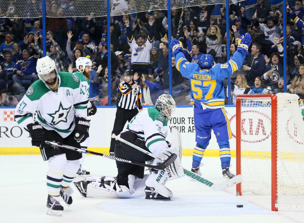 The St. Louis Blues' David Perron, right, reacts after teammate Patrik Berglund scored the go-ahead goal past Dallas Stars goaltender Antti Niemi late in the third period on Saturday at the Scottrade Center in St. Louis.