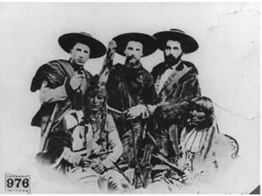Santa Fe Trail freighters Bernard Seligman, Zadoc Staab and Lehman Spiegelberg are pictured with their Kiowa Indian scouts in this undated photo.