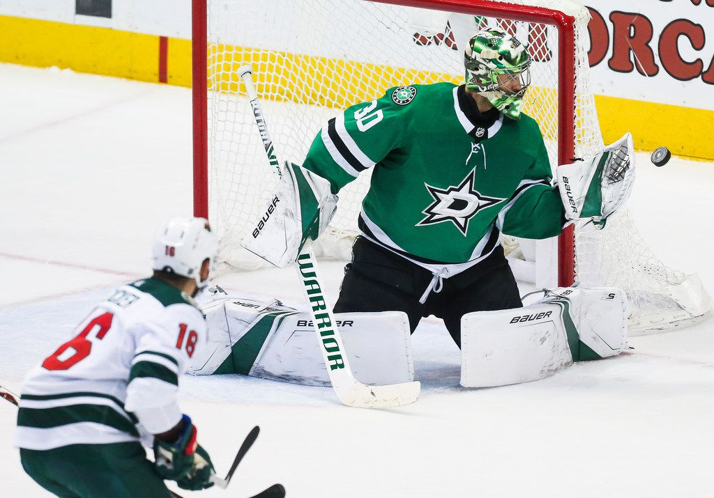 Dallas Stars goaltender Ben Bishop (30) blocks a Minnesota Wild shot on goal during the third period of a match between the Dallas Stars and the Minnesota Wild on Friday, Feb. 1, 2019 at the American Airlines Center in Dallas. (Ryan Michalesko/The Dallas Morning News)