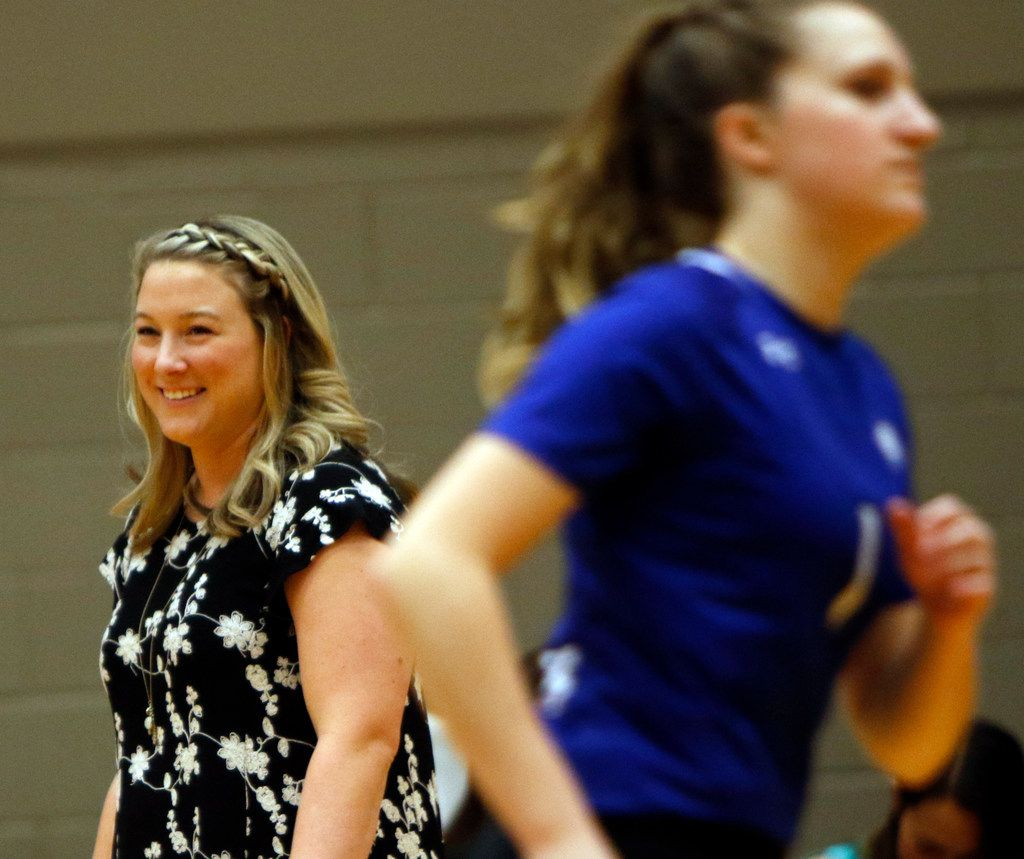 Trophy Club Byron Nelson head coach Brianne Barker-Groth beams after her Lady Bobcats won a point enroute to their 25-18, 25-17 and 25-16 victory over Denton Guyer to advance to the state tournament. The two teams played their Class 6A Region l championship volleyball match at W.G. Thomas Coliseum in Haltom City on November 16, 2019. (Steve Hamm/ Special Contributor)