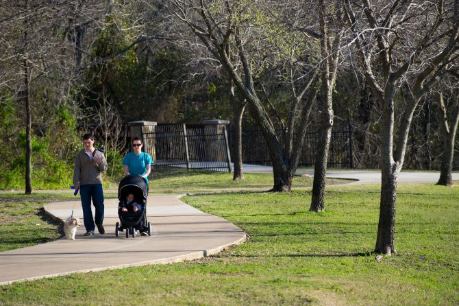 Cody and Karissa Kell took a walk with their 8-month-old daughter, Audrey, and dog Kyra at the Spring Creek Nature Area in Richardson.