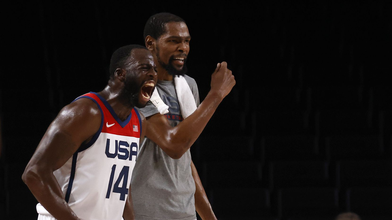 USA's Draymond Green (14) and Kevin Durant (7) celebrate a made basket in a game against Australia during the second half of a men's basketball semifinal at the postponed 2020 Tokyo Olympics at Saitama Super Arena, on Thursday, August 5, 2021, in Saitama, Japan. USA defeated Australia 97-78 to advance to the gold medal game.