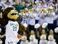 Baylor Bears mascot leads the crowd in a cheer during the second half of an NCAA men's basketball game between Baylor University and Kansas University on Saturday, February 22, 2020 at Ferrell Center on the Baylor University Campus in Waco.