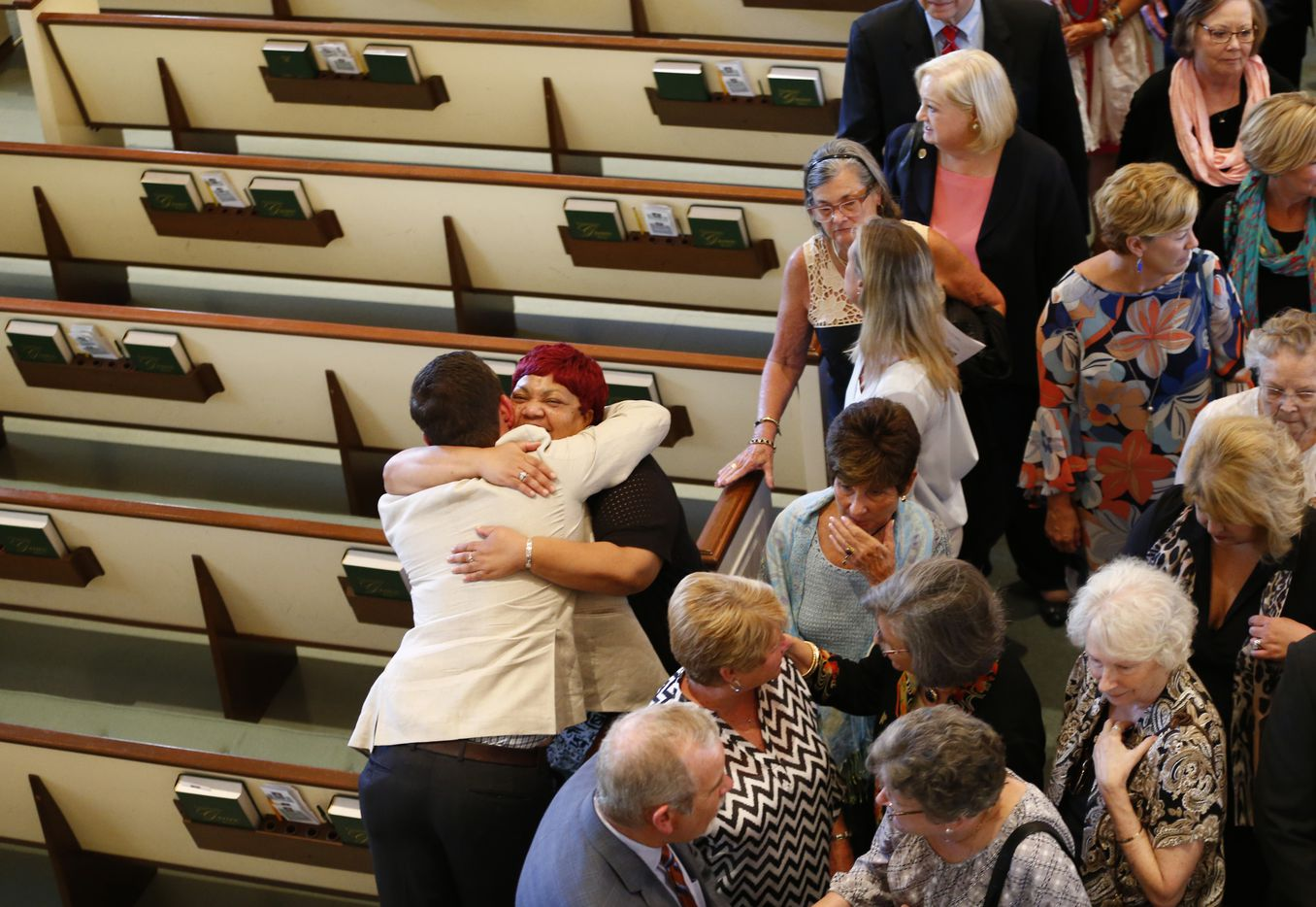 People great each other after the funeral for Vickie Vivian Paulette Thompson at Wilshire Baptist Church in Dallas on July 13, 2017.