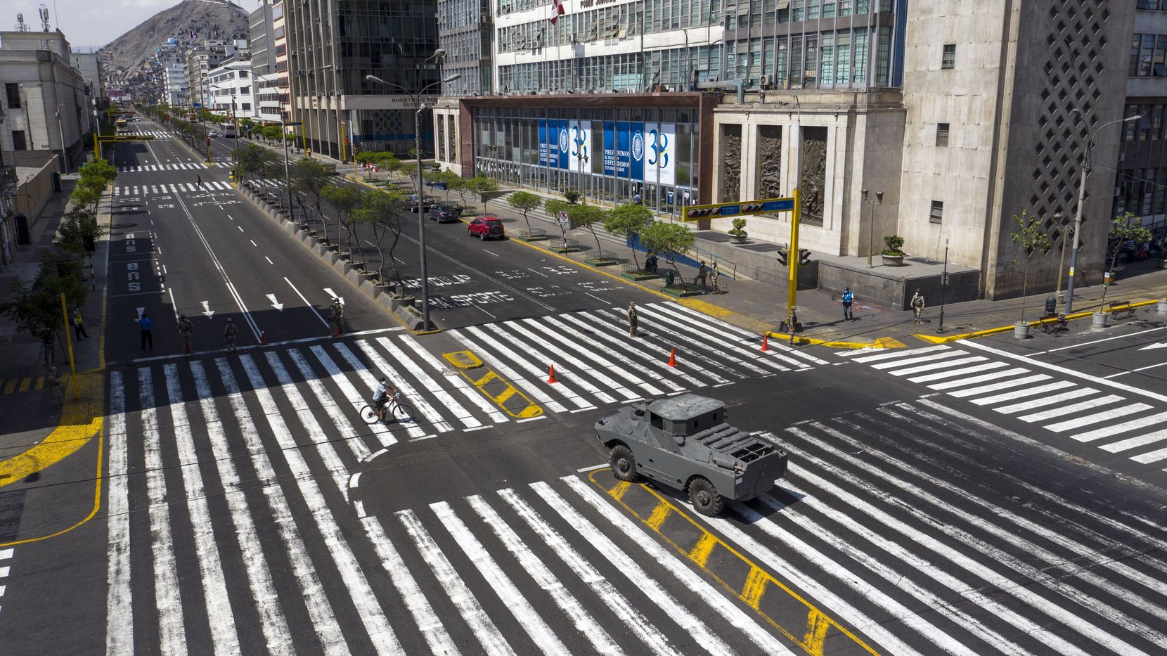 An armored vehicle guards an intersection on Abancay Avenue after the government implemented restrictions to prevent the spread of the new coronavirus in Lima, Peru, on March 18, 2020. (Rodrigo Abd/The Associated Press)