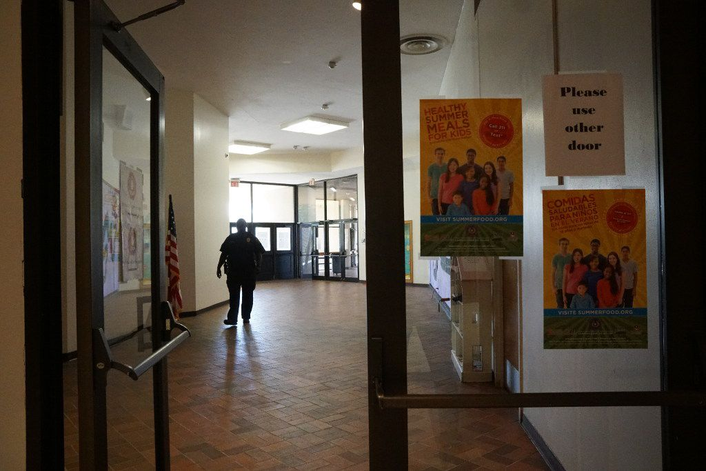 A security guard walks the halls at Manns Education Center in Dallas on June 21, 2017. The school board will vote this week on whether to close the school.