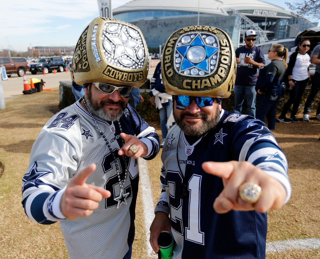 Brothers Steven, left, and Christopher Saucedo, both of San Antonio, TX, sport their own Super Bowl Rings, while tailgating on the AT&T Stadium parking lot before the Los Angeles Rams Vs. Dallas Cowboys NFL football game on Sunday, December 15, 2019. (John F. Rhodes / Special Contributor)