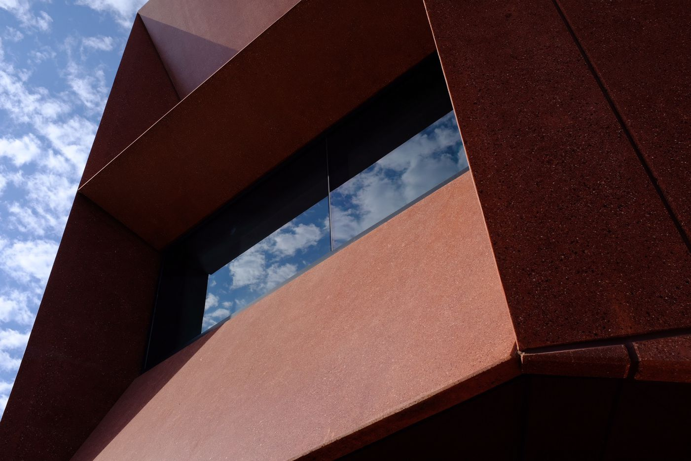 Shadows and reflections on the chiseled concrete block of Ruby City, David Adjaye, architect.