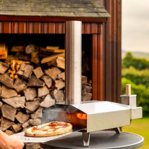 The Ooni Wood Fired Pizza Oven, $275, can be used outdoors on a tabletop.